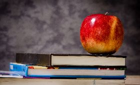 text-books-and-an-apple