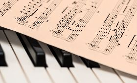 music-sheet on-a piano