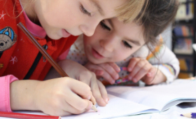 children-writing-together